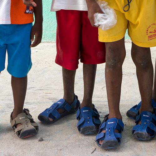 Help kids by giving Shoes That Grow.